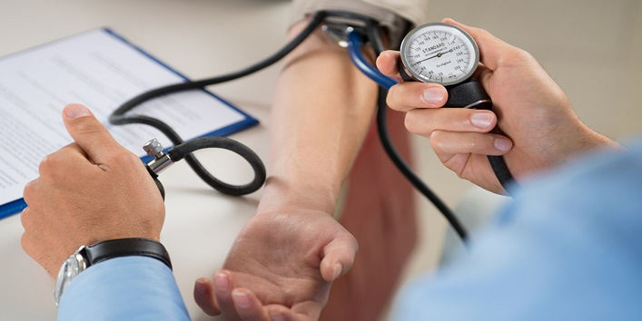 Close Up Of A Doctor Checking Blood Pressure Of A Patient;  accuracy; blood; blood pressure; cardiologist; care; check; checking blood pressure; checkup; clinic; clinical; clipboard; closeup; diagnose; diagnosis; diagnostics; doctor; exam; examination; examine; expertise; hand; health; healthcare; healthy; holding; hospital; hypertension; ill; illness; indoor; instrument; job; male; man; measurement; measuring; medical; occupation; patience; patient; people; pressure; professional; pulse; pulsometer; test; treatment; two; visit; woman