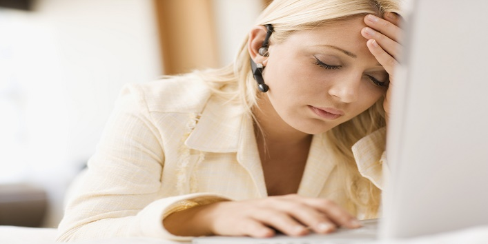 Tired woman in front of laptop computer