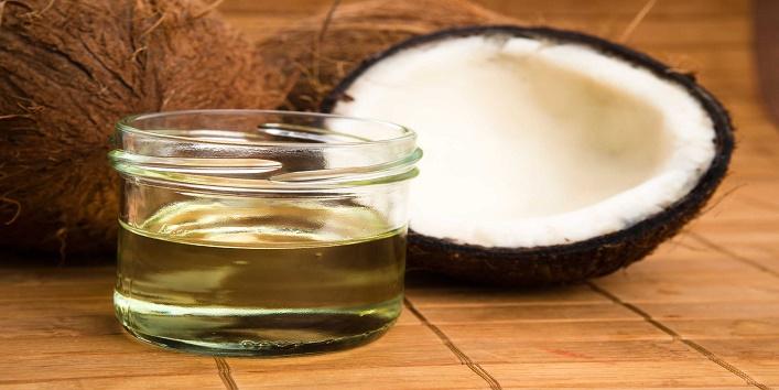 Warm coconut oil treatment for shiny hair