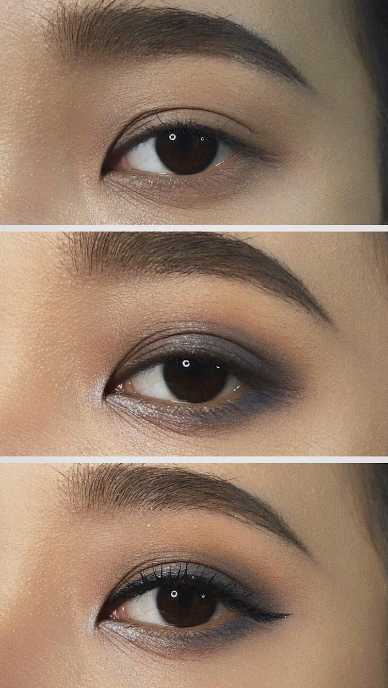 Tán phấn nhũ bạc dưới khóe mắt giúp bắt sáng và tạo hiệu ứng đôi mắt to tròn hơn. Sau đó dùng Eyeliner kẻ dáng mắt mèo và gắn thêm mi giả là chúng ta đã hoàn thiện bước make up mắt khói này rồi. Đây là một
