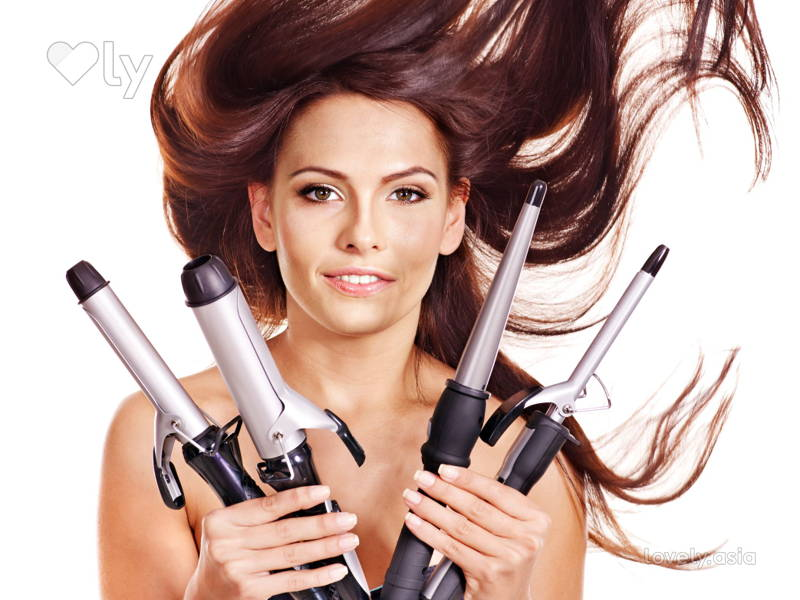 Girl holding hair tools