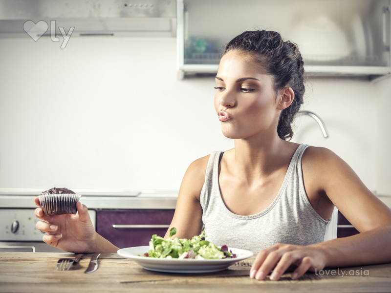 woman enjoying her healthy meal at home