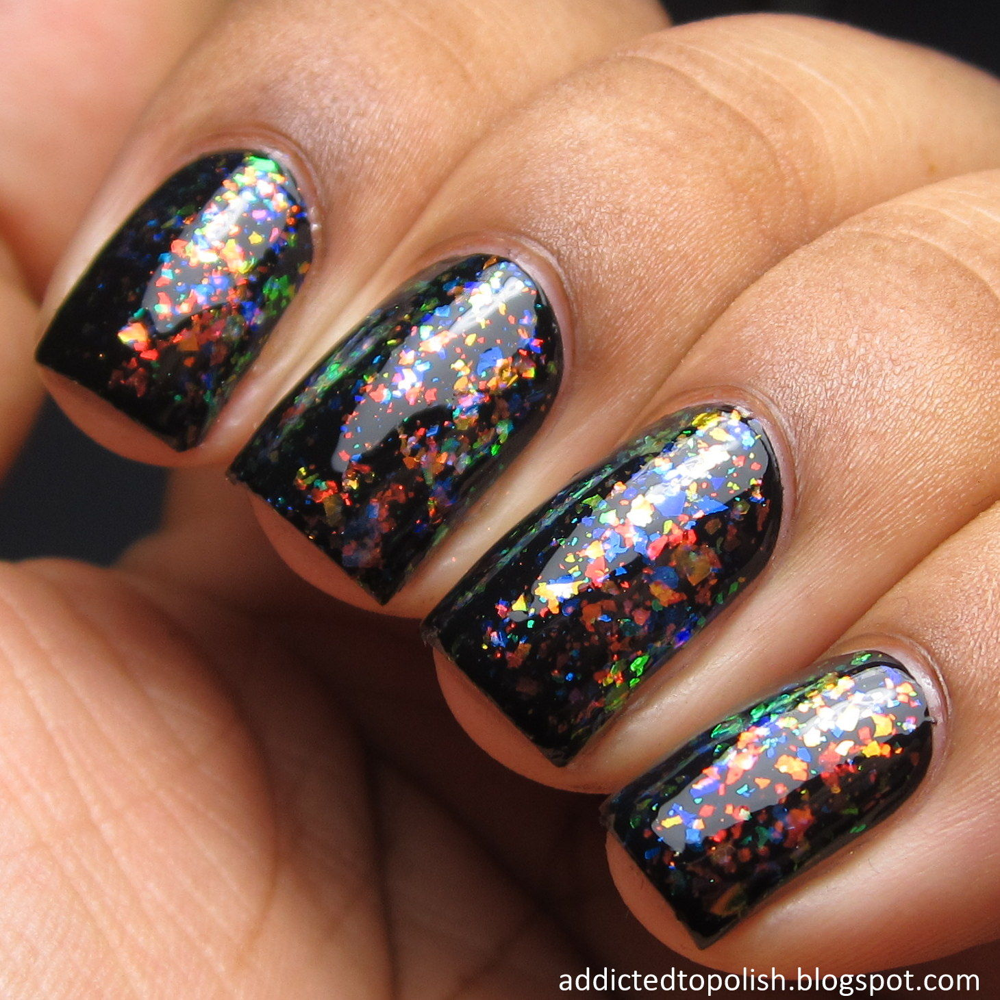 Black colourful glitter nail polish
