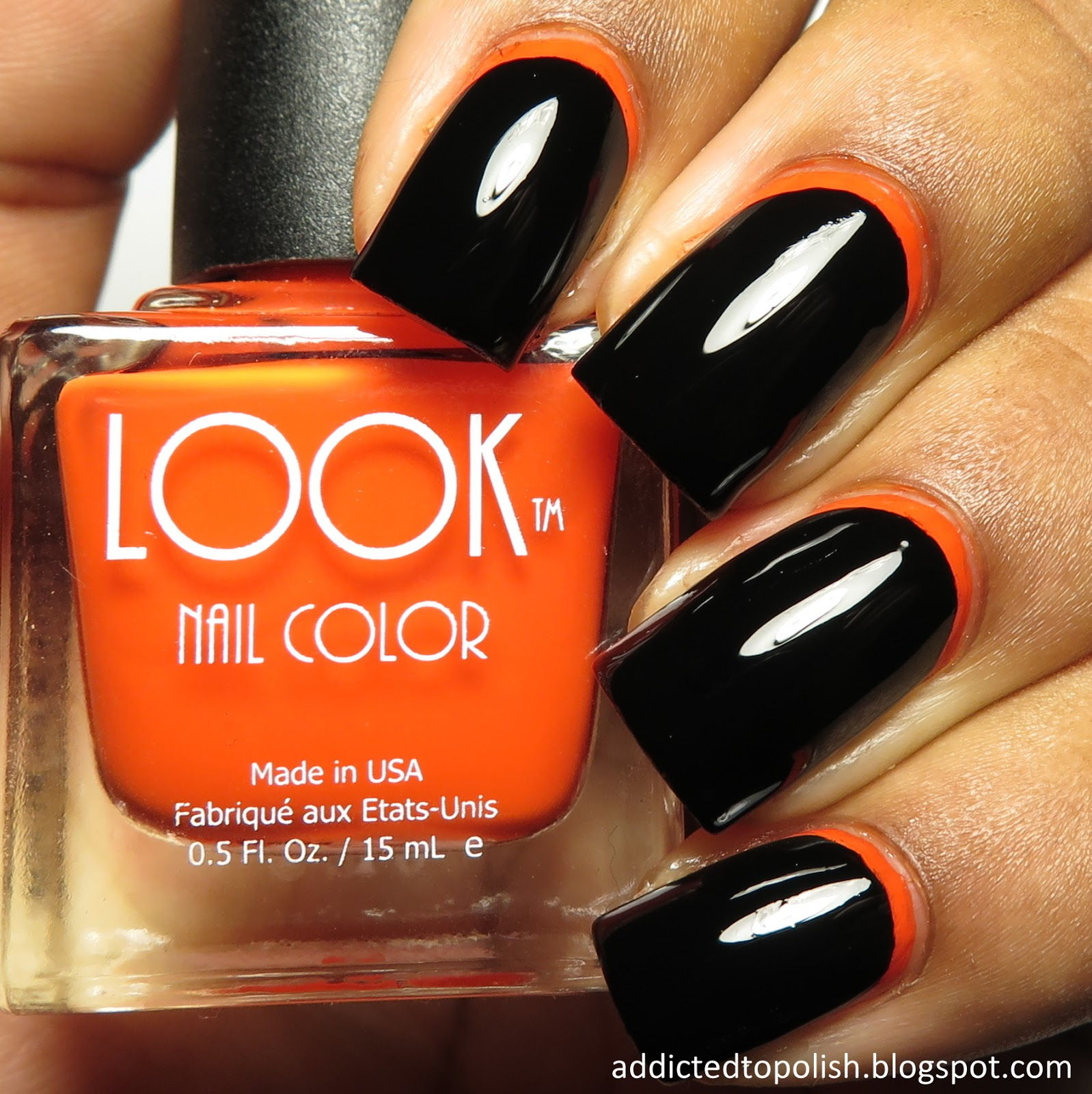 Black orange reverse french manicure