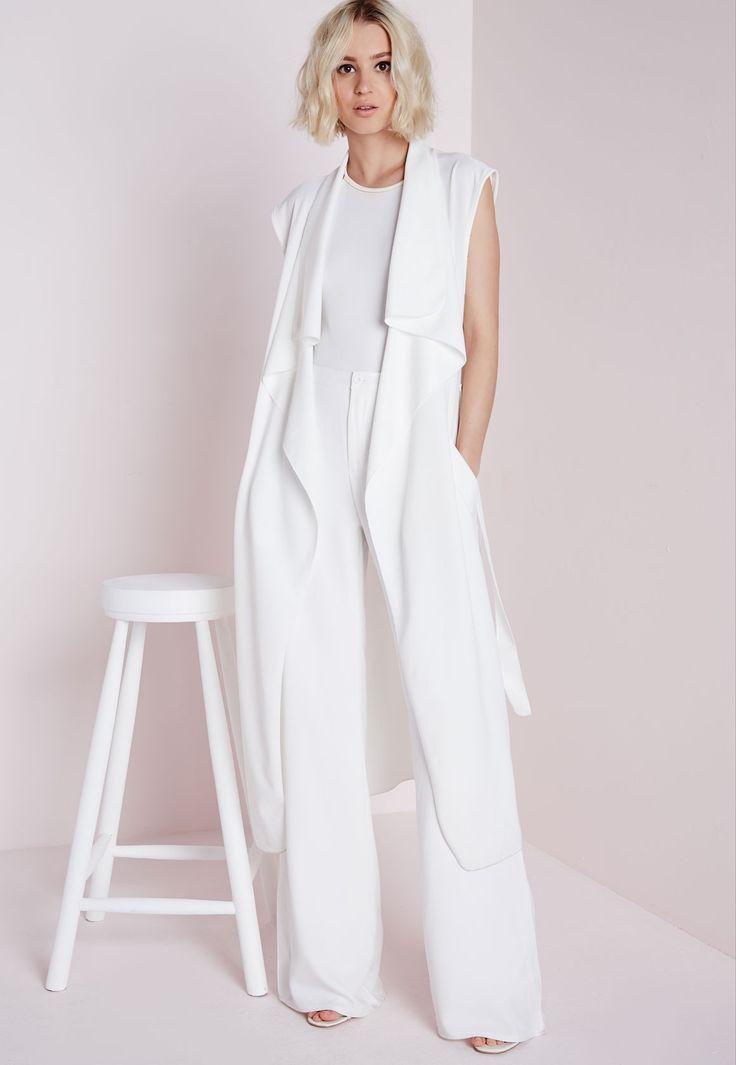 sleeveless white coat