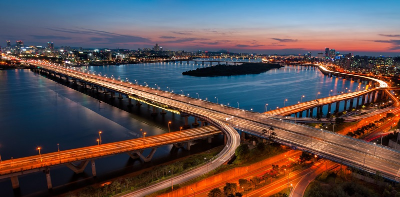 A colorful sunset over the Yeouido business district and the Han River of Seoul, South Korea.