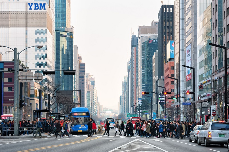 Pedestrians cross the street in the Gangnam district of Seoul, South Korea.