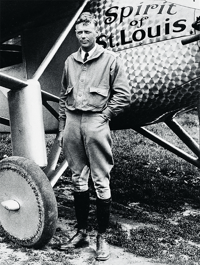 Charles Lindbergh with his Spirit of St. Louis plane