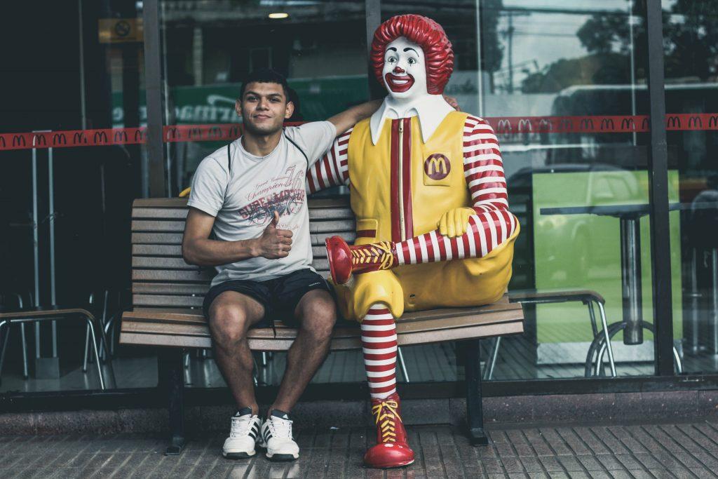 Customer Experience Strategies in 2021 - man sitting next to ronald macdonald