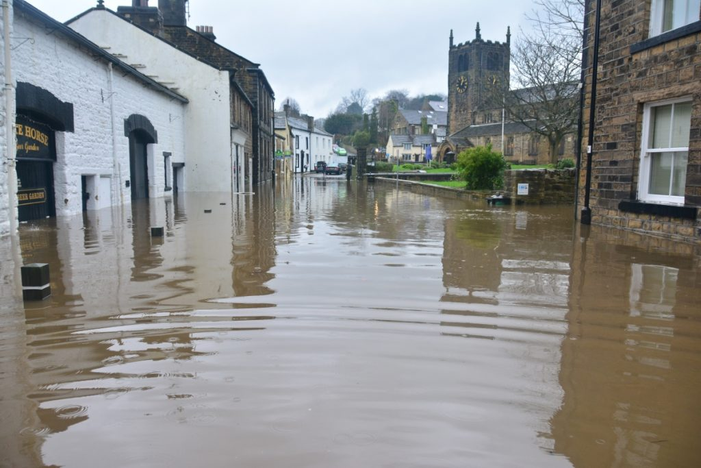 A flood in the UK, showing the need for climate adaptation in some areas.