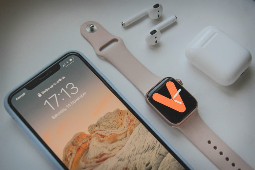 Image showing an iPhone, Apple Watch and AirPods.
