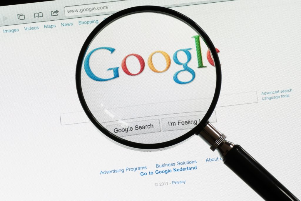 Google eCommerce best practices - image of google in a browser with a magnifying glass.