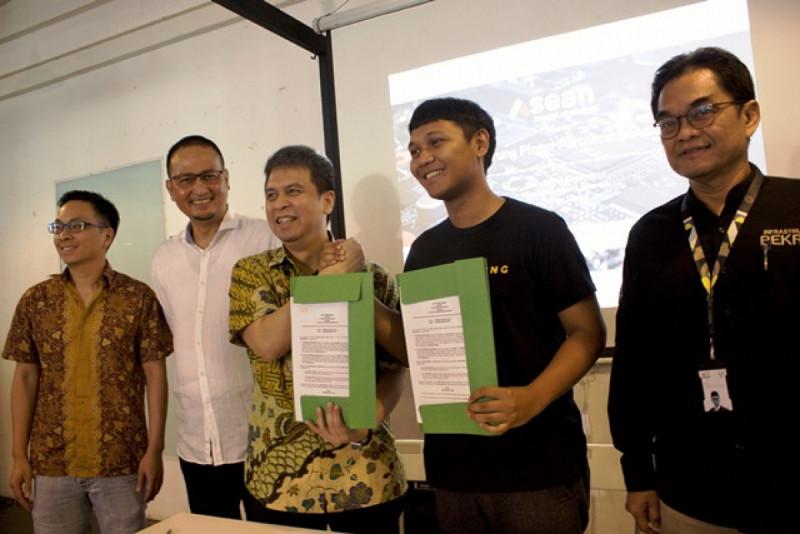Penandatanganan MoU Grab dan Warung Pintar pada Kamis, (24/1/2019). Foto: Grab.
