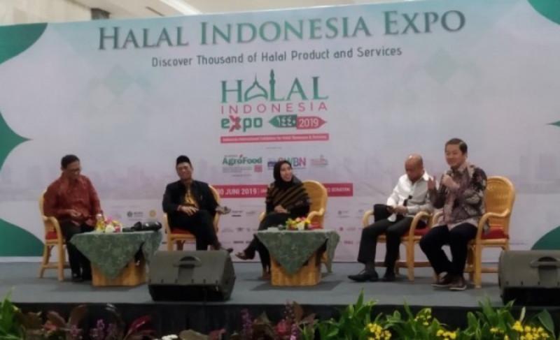 Ketua GAPMMI Adhi Lukman dalam seminar Halal Indonesia Expo 2019 di Jakarta, Jumat (28/6/2019). Foto: Antara