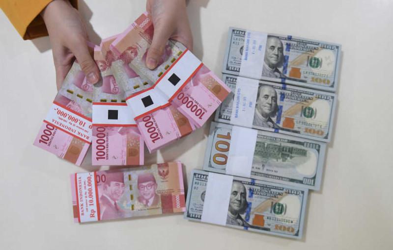 Ilustrasi rupiah dan dolar. (Foto: Antara)