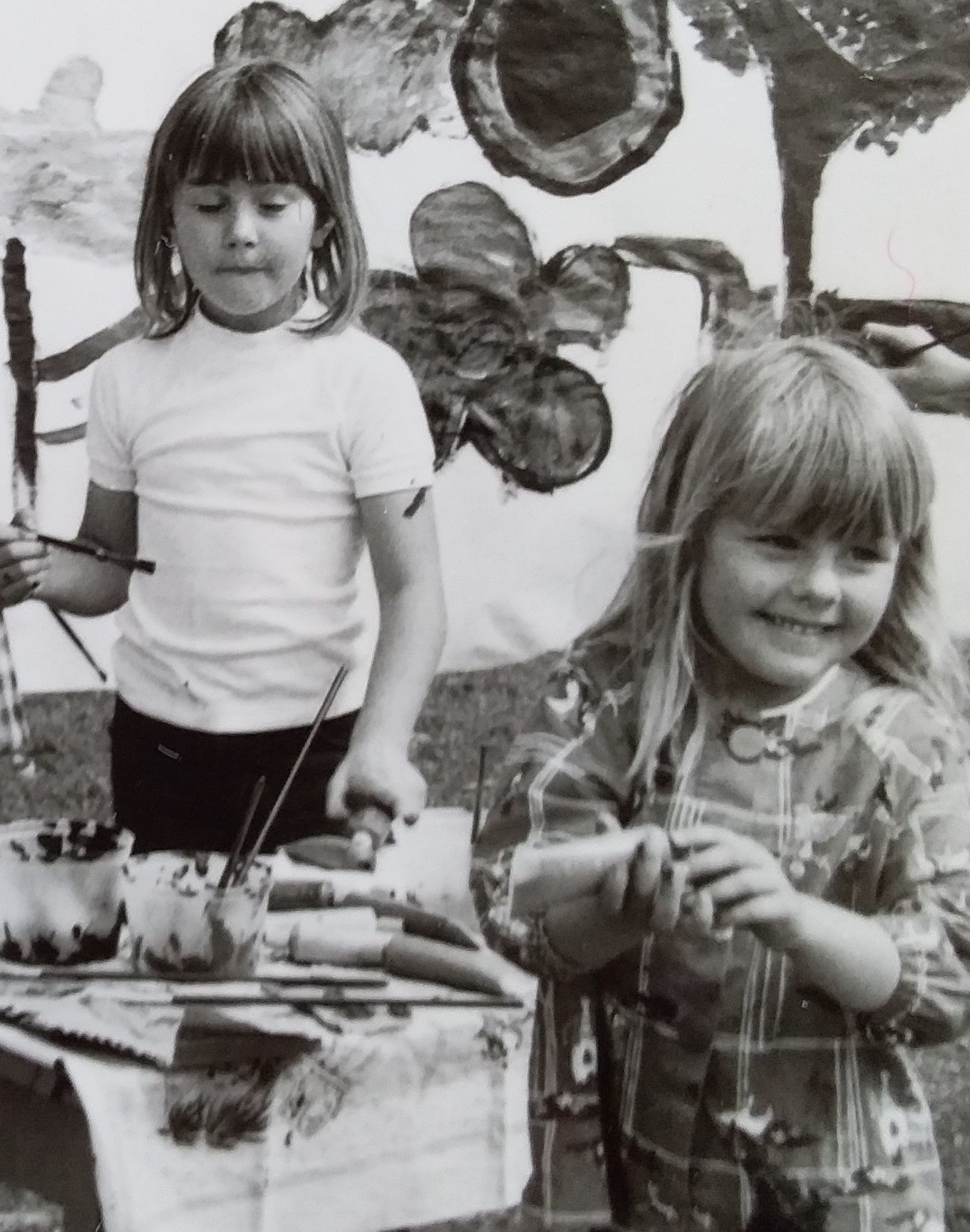 Lara Painting as child with sister Karly.jpg