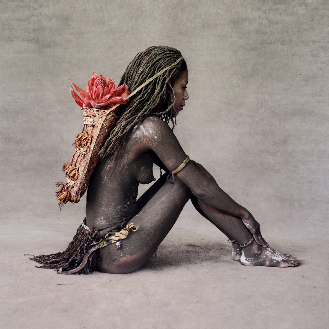 Fred Stichnoth - Girl with Red Ginger Flower, New Guinea.jpg