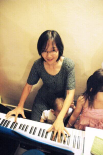Joy on piano with Latimer