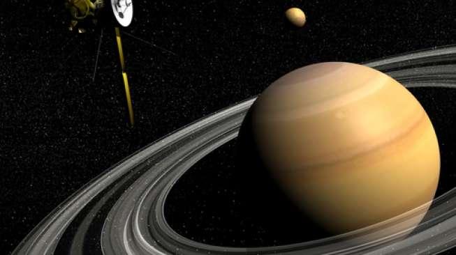 Saturnus, Titan, dan wahana antariksa Cassini (NASA/Shutterstock).