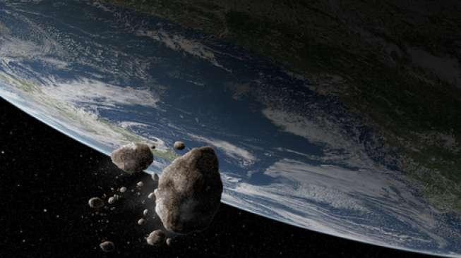 Ilustrasi asteroid melesat di dekat Bumi (Shutterstock).