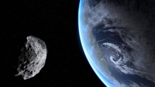 Ilustrasi sebuah asteroid sedang melintas dekat Bumi. [Shutterstock]