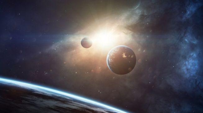 Keindahan luar angkasa yang dihiasi planet, bintang, dan galaksi di alam semesta yang tak berujung. (Shutterstock)