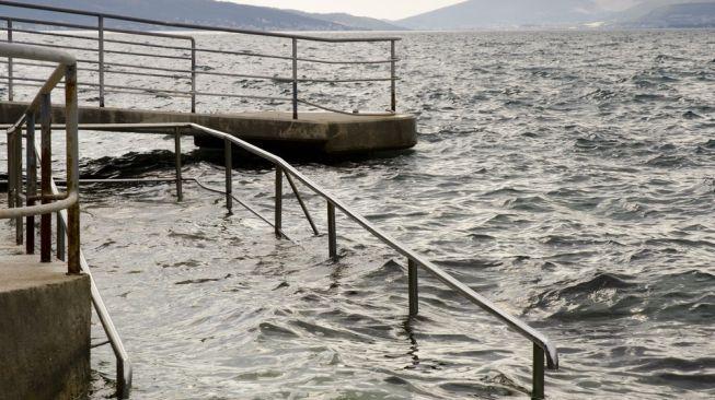Ilustrasi permukaan laut naik. [Shutterstock]