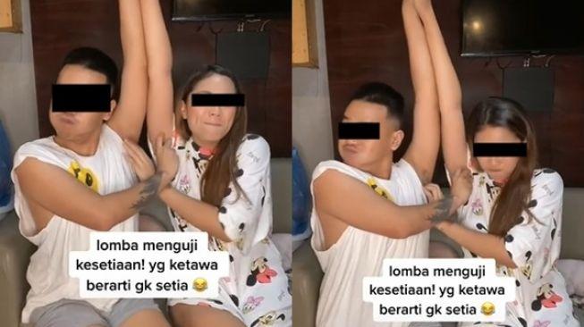Viral Pasangan Gelitik Ketiak Satu Sama Lain Bikin Bengek. (TikTok/@vitosinaga)