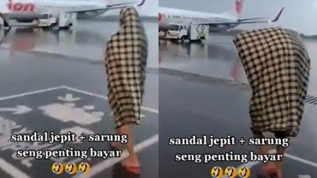 Viral Pria Pakai Sarung dan Sandal Jepit Kejar Pesawat. (TikTok/@estiwinadhif)