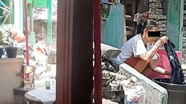 Viral Ibu-ibu Cuci Baju di depan Tetangga yang Lagi Hajatan. (TikTok)
