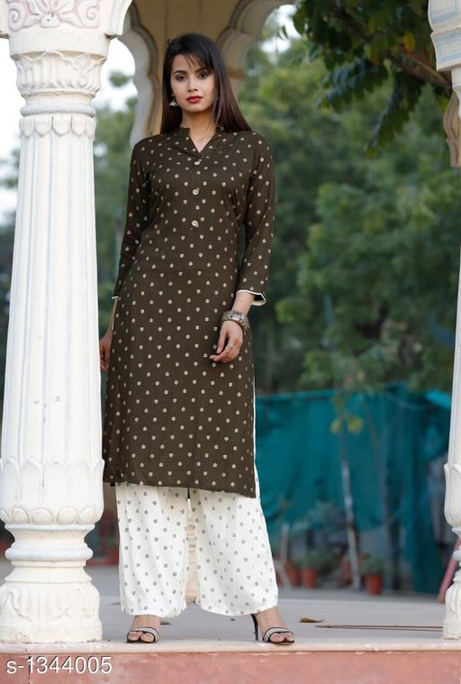 Kurta Sets Contemporary Women's Kurti & Kurta Set  *Fabric* Rayon  *Sleeves* Sleeves Are Included  *Size* Kurti - M - 38 in, L - 40 in, XL - 42 in, XXL - 44 in ,  3XL - 46 in ,Palazzo - M - 30 in, L - 32 in, XL - 34 in, XXL - 36 in ,3XL - 38 in  *Length* Kurti - Up To 48 in, Palazzo - Up To 40 in  *Type* Stitched  *Description* It Has 1 Piece Of Women's Kurti & 1 Piece Of Palazzo  *Work* Kurti - Printed, Palazzo - Solid  *Sizes Available* XL   Supplier Rating: ★4.2 (260) SKU: Dark Green Patti Kurta Palazzo Set-m Free shipping is available for this item. Pkt. Weight Range: 300  Catalog Name: Kashvi Contemporary Women's Kurti & Kurta Sets Vol 3 - NIK Fashion Code: 967-1344005--