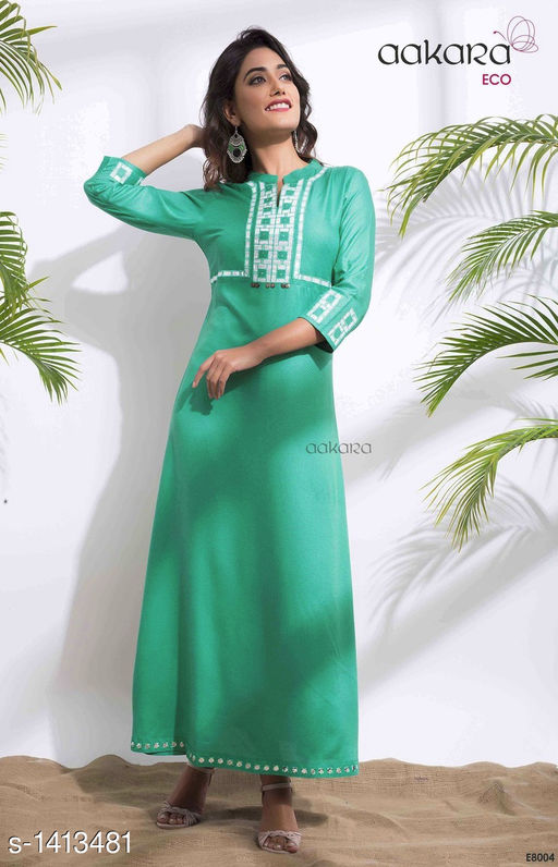Kurtis & Kurtas Elegant Women's Rayon Dobby Kurtis  *Fabric* Rayon Dobby  *Sleeves* 3/4 Sleeves Are Included  *Size* XL - 42 in  *Length* Up To 49 in  *Type* Stitched  *Description* It Has 1 Piece Of Kurti  *Work* Mirror Work  *Sizes Available* XL   Supplier Rating: ★3.9 (54) SKU: EB004 Free shipping is available for this item. Pkt. Weight Range: 350  Catalog Name: Yashvi Adorable Mirror Work Rayon Kurtis  - Anuradha B Code: 5201-1413481--