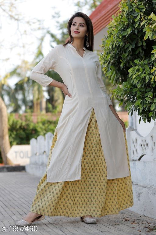 Kurtis & Kurtas Stylish Women's Kurti  *Fabric* Kurti - Rayon , skirt - Cotton Slub , Flair - 3 Mtr  *Sleeves* 3/4 Sleeves Are Included  *Size* Kurti - M - 38 in , L - 40 in , XL - 42 in , XXL - 44 in , Skirt - M - 30 in , L - 32 in , XL - 34 in , XXL - 36 in  *Length* Kurti - Up To 46 in , Skirt - Up To 39 in  *Type* Stitched  *Description* It Has 1 Piece Of Women's Kurti With 1 Piece Of Skirt  *Work* Kurti - Solid, Skirt - Printed  *Sizes Available* M, L, XL, XXL   Catalog Rating: ★3.8 (5) Supplier Rating: ★4 (1314) SKU: SKUKS07-1  Free shipping is available for this item. Pkt. Weight Range: 400  Catalog Name: Kalakurti Stylish Women's Kurtis Vol 11 - New Jaipur Fashion Code: 968-1957460--