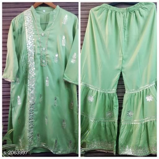 Kurtis & Kurtas  Casual Kurti Skirt Set   *Fabric* Kurti – Rayon   , Skirt- Rayon  *Sleeves* Kurti - 3/4th Sleeves Are Included  *Size* Kurti- M- 38 in,L - 40 in, XL - 42 in,Skirt - M- 30 in,L - 32 in, XL - 34 in  *Length* Kurti - Up To 46 in, Skirt - Up To 39 in  *Type* Stitched  *Description* It Has 1 Piece Of Kurti &1 Piece Of Skirt  *Work* Gotta Patti  *Sizes Available* XL, XXL   Supplier Rating: ★3.9 (341) SKU: sk26 Free shipping is available for this item. Pkt. Weight Range: 500  Catalog Name: Eva Casual  Kurti Skirt Set   - FBK Styles Code: 969-2063997--