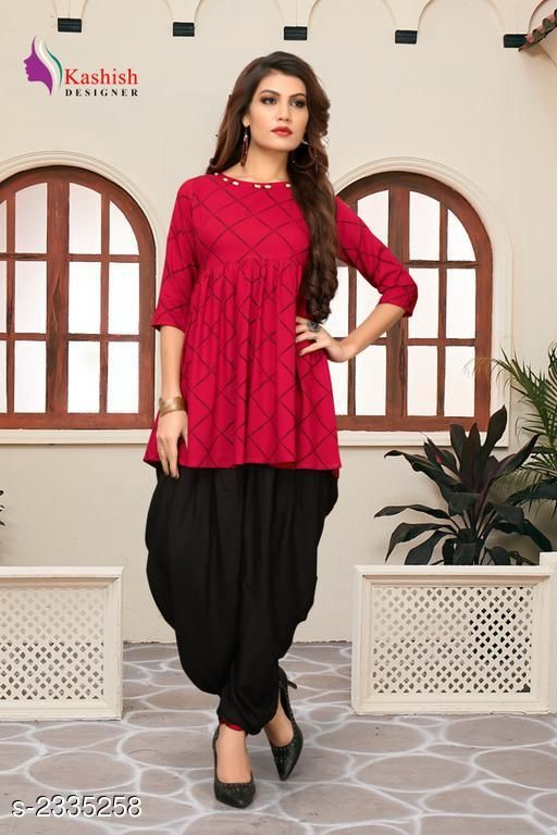 Top & Bottom Sets Pretty Pure Rayon Women's Patiala Pant  *Fabric* Kurti - Pure Rayon, Patiala Pant - Pure Rayon   *Sleeves* Sleeves Are Included   *Size* Kurti - S _36 in,  M - 38 in,  L - 40 in,  XL -  42 in, Patiala Pant - S _28 in,  M - 30 in,  L - 32 in,  XL -  34 in   *Length* Up To 28 in   *Type* Stitched   *Description* It Has 1 Piece Of Women's Kurti With Patiala Pant   *Pattern* Checkered  *Sizes Available* S, M, L, XL   SKU: 4_512 Free shipping is available for this item. Pkt. Weight Range: 500  Catalog Name: Adaline Pretty Pure Rayon Women's Patiala Pants Vol 1 - DSTAR KALKI Code: 9611-2335258--