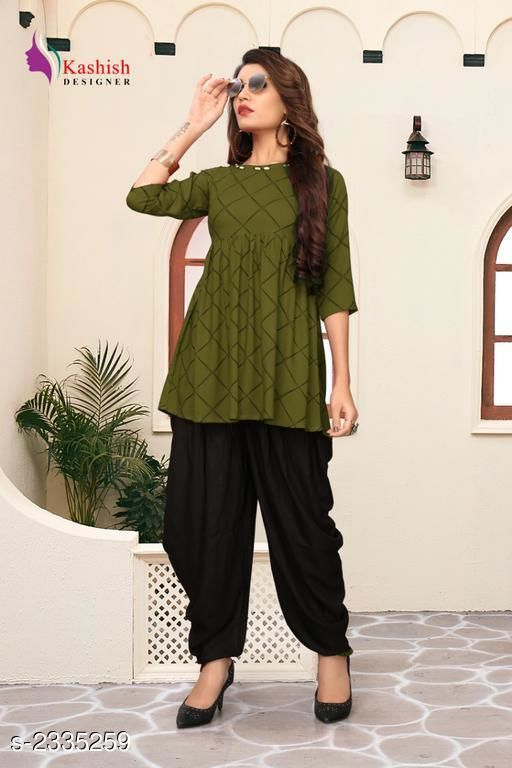 Top & Bottom Sets Pretty Pure Rayon Women's Patiala Pant  *Fabric* Kurti - Pure Rayon, Patiala Pant - Pure Rayon   *Sleeves* Sleeves Are Included   *Size* Kurti - S _36 in,  M - 38 in,  L - 40 in,  XL -  42 in, Patiala Pant - S _28 in,  M - 30 in,  L - 32 in,  XL -  34 in   *Length* Up To 28 in   *Type* Stitched   *Description* It Has 1 Piece Of Women's Kurti With Patiala Pant   *Pattern* Checkered  *Sizes Available* S, M, L, XL   SKU: 3_512 Free shipping is available for this item. Pkt. Weight Range: 500  Catalog Name: Adaline Pretty Pure Rayon Women's Patiala Pants Vol 1 - DSTAR KALKI Code: 9611-2335259--