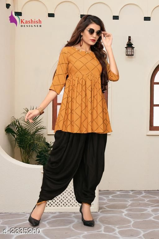 Top & Bottom Sets Pretty Pure Rayon Women's Patiala Pant  *Fabric* Kurti - Pure Rayon, Patiala Pant - Pure Rayon   *Sleeves* Sleeves Are Included   *Size* Kurti - S _36 in,  M - 38 in,  L - 40 in,  XL -  42 in, Patiala Pant - S _28 in,  M - 30 in,  L - 32 in,  XL -  34 in   *Length* Up To 28 in   *Type* Stitched   *Description* It Has 1 Piece Of Women's Kurti With Patiala Pant   *Pattern* Checkered  *Sizes Available* S, M, L, XL   SKU: 2_512 Free shipping is available for this item. Pkt. Weight Range: 500  Catalog Name: Adaline Pretty Pure Rayon Women's Patiala Pants Vol 1 - DSTAR KALKI Code: 9611-2335260--
