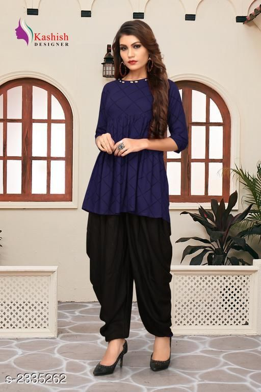Top & Bottom Sets Pretty Pure Rayon Women's Patiala Pant  *Fabric* Kurti - Pure Rayon, Patiala Pant - Pure Rayon   *Sleeves* Sleeves Are Included   *Size* Kurti - S _36 in,  M - 38 in,  L - 40 in,  XL -  42 in, Patiala Pant - S _28 in,  M - 30 in,  L - 32 in,  XL -  34 in   *Length* Up To 28 in   *Type* Stitched   *Description* It Has 1 Piece Of Women's Kurti With Patiala Pant   *Pattern* Checkered  *Sizes Available* S, M, L, XL   SKU: 1_512 Free shipping is available for this item. Pkt. Weight Range: 500  Catalog Name: Adaline Pretty Pure Rayon Women's Patiala Pants Vol 1 - DSTAR KALKI Code: 9611-2335262--