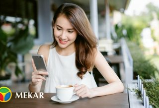 Women Smiling While Holding Her Smartphone