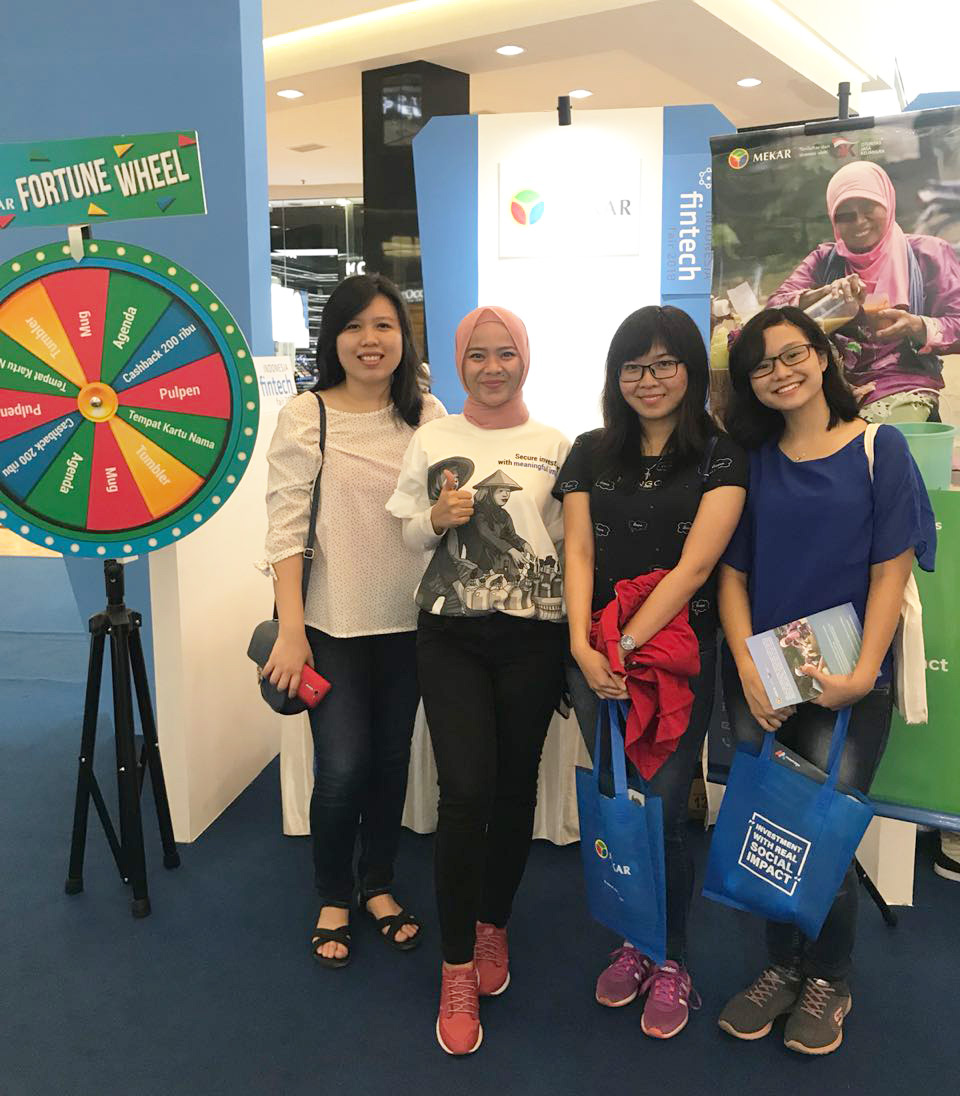 Stand Visitors Taking Picture with Mekar's Relationship Manager, Yunita Anggraini