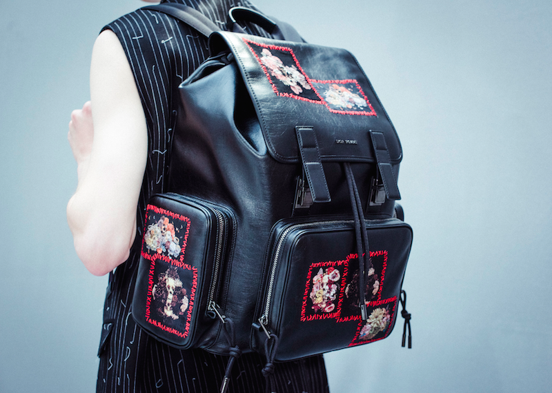 "Backpack with the season's embroidered ""Vanite Patches"", as well as oversized zip pockets from Dior Homme's Summer 2017 collection. Photography by Morgan O'Donovan"