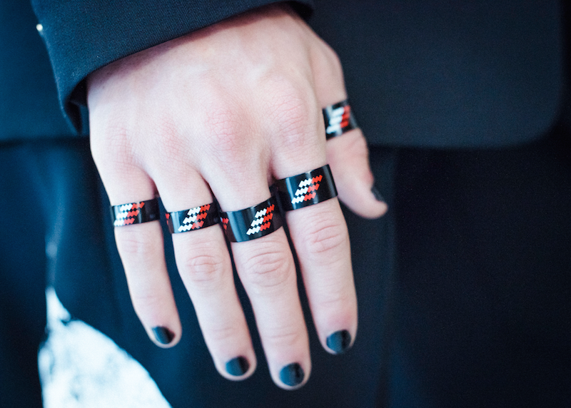 Metal rings have a black lacquered finish, and are stamped with a red and white pad print motif in Dior Homme's Summer 2017 collection. Photography by Morgan O'Donovan