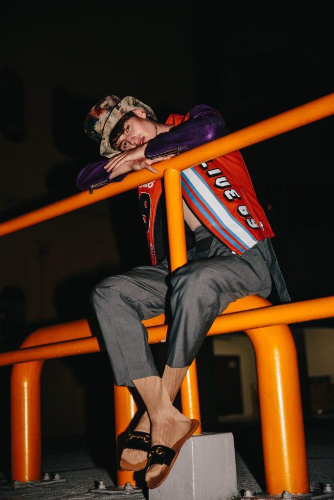 Kenzo Leather jacket, cotton tank, cotton pants; Gucci Wool socks, leather slides; Yohji Yamamoto from Club21 Mens Cotton hat