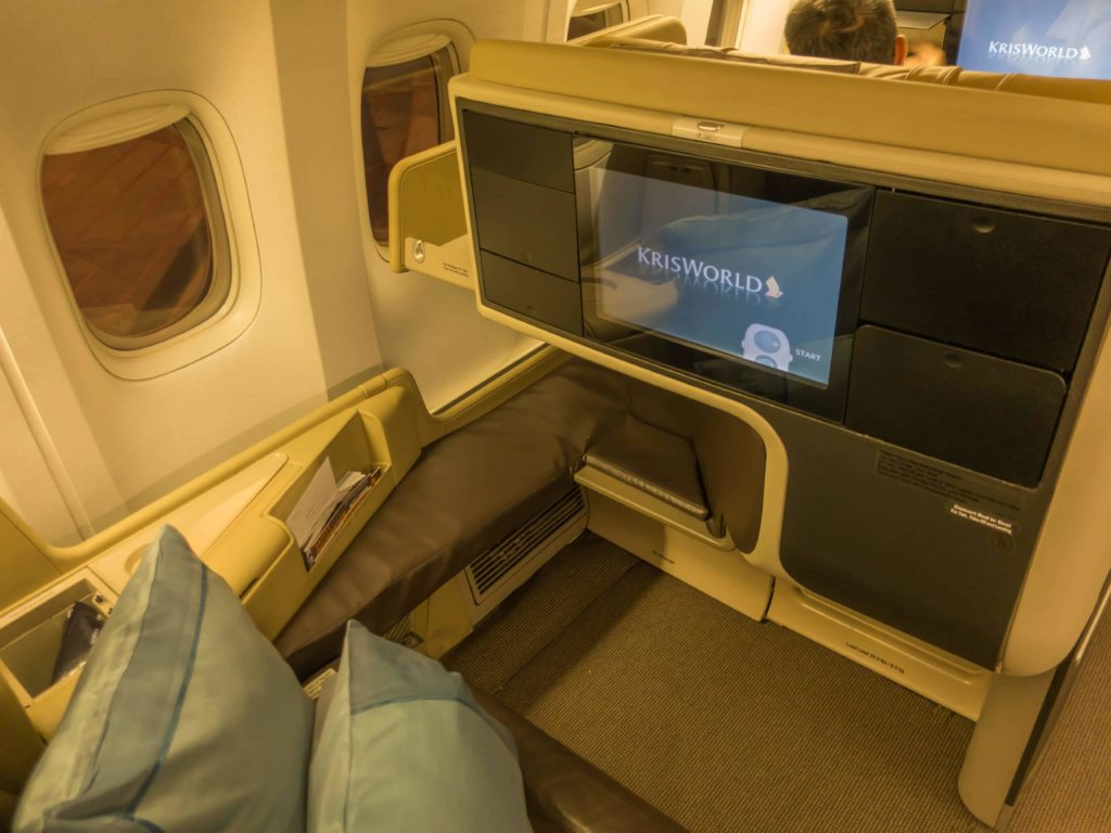 In-Flight Entertainment screen and foot well of the seat