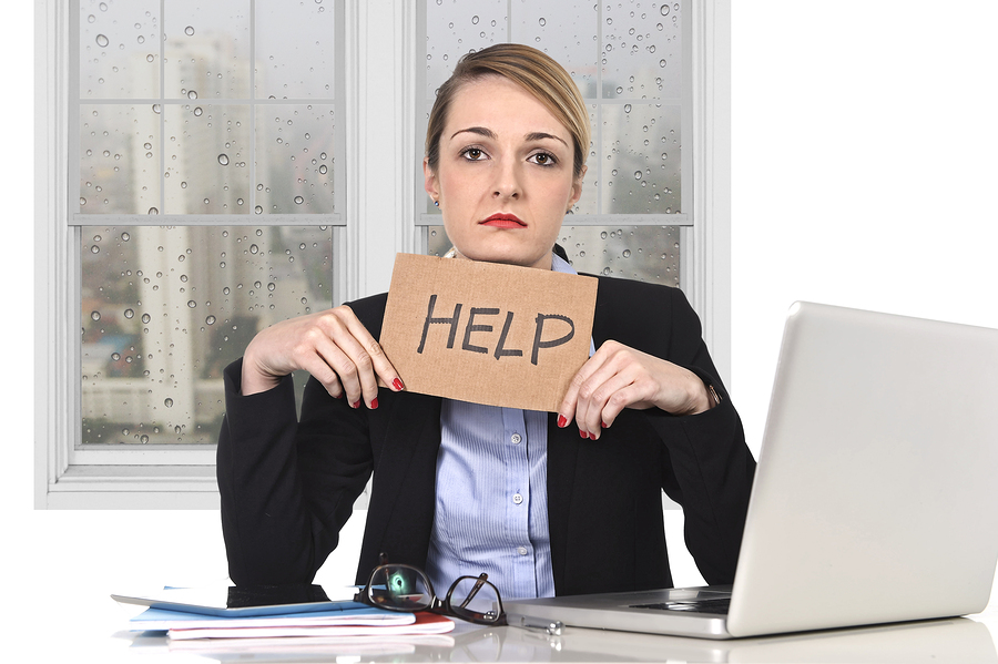 Young Stressed Businesswoman Holding Help Sign Overworked At Off