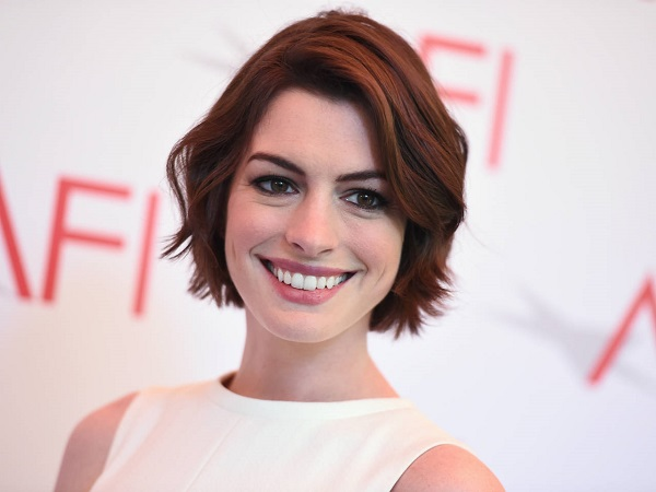 "FILE - In this Friday, Jan. 9, 2015 file photo, Anne Hathaway arrives at the AFI Awards at The Four Seasons Hotel in Los Angeles. Hathaway was not supposed to star in ""Song One,"" an indie musical about a disconnected twenty something in a crisis who finds herself in folk music. One year after its Sundance Film Festival premiere, the actress laughed about the awkwardness of having to ask her director to be in the film, which is now playing in select theaters and on video-on-demand. (Photo by Jordan Strauss/Invision/AP, File)"