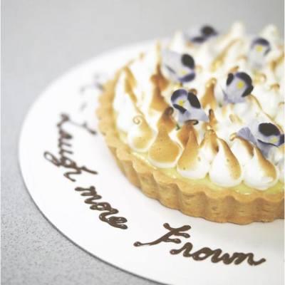 Lemon meringue tart with edible fresh flowers :)