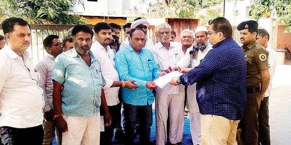 Farmers, MLA Harshad Ribadiya demand FIR in tuar dal scam