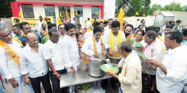 Protesters serve food at closed canteen in Ongole