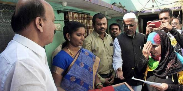 Beneficiaries receive cheques from MLA at their doorstep